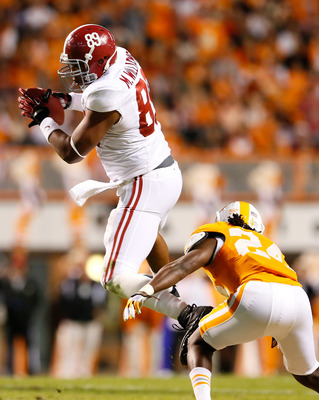 KNOXVILLE, TN - OCTOBER 20:  Michael Williams #89 of the Alabama Crimson Tide pulls in this receptoin against Eric Gordon #24 of the Tennessee Volunteers at Neyland Stadium on October 20, 2012 in Knoxville, Tennessee.  (Photo by Kevin C. Cox/Getty Images)