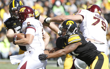 Fisher (right) clears the way against Iowa.