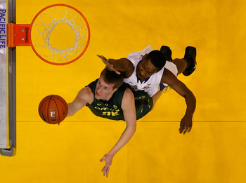 Oregon's E.J. Singler attempting a layup.