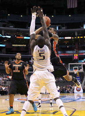 Aziz N'Diaye going for the block.