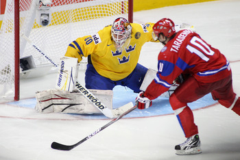 BUFFALO, NY - JANUARY 03:  Robin Lehner #30 of Sweden defends against Vladimir Tarasenko #10 of Russia in the shootout during the 2011 IIHF World U20 Championship Semi Final game between Sweden and Russia on January 3, 2011 in Buffalo, New York. Russia wo