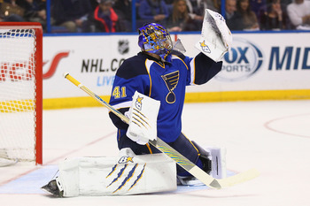 ST. LOUIS, MO - JANUARY 19: Jaroslav Halak #41 of the St. Louis Blues makes a save against the Detroit Red Wings at the Scottrade Center on January 19, 2013 in St. Louis, Missouri.  (Photo by Dilip Vishwanat/Getty Images)