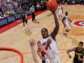 COLUMBUS, OH - JANUARY 13:  Deshaun Thomas #1 of the Ohio State Buckeyes shoots over Nik Stauskas #11 of the Michigan Wolverines in the second half for two of his game high 20 points on January 13, 2013 at Value City Arena in Columbus, Ohio. Ohio State de