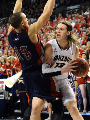 Jan. 10, 2013; Spokane, WA, USA; Gonzaga Bulldogs forward Kelly Olynyk (13) puts up a shot against Saint Mary's Gaels forward Beau Levesque (15) during the second half at the McCarthey Athletic Center. The Bulldogs beat the Gaels by a final score of 83-78