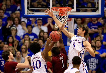 LAWRENCE, KS - JANUARY 06:  Jeff Withey #5 of the Kansas Jayhawks blocks a shot by Khalif Wyatt #1 of the Temple Owls during the game at Allen Fieldhouse on January 6, 2013 in Lawrence, Kansas.  (Photo by Jamie Squire/Getty Images)