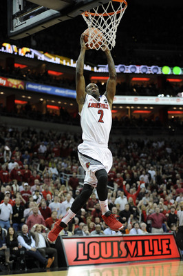 Jan 19, 2013; Louisville, KY, USA;  Louisville Cardinals guard Russ Smith (2) drives to the basket against the Syracuse Orange during the second half at the KFC Yum! Center.  Syracuse defeated Louisville 70-68.  Mandatory Credit: Jamie Rhodes-USA TODAY Sp
