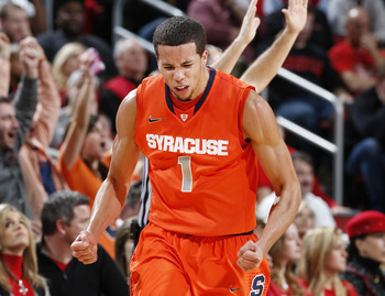 LOUISVILLE, KY - JANUARY 19: Michael Carter-Williams #1 of the Syracuse Orange reacts after hitting a three-point shot against the Louisville Cardinals during the game at KFC Yum! Center on January 19, 2013 in Louisville, Kentucky. Syracuse defeated Louis