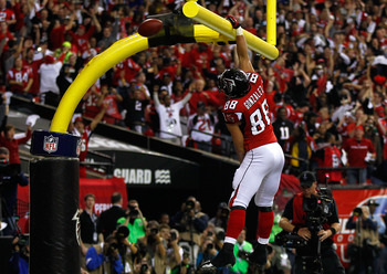 Tony Gonzalez's patented touchdown celebration.