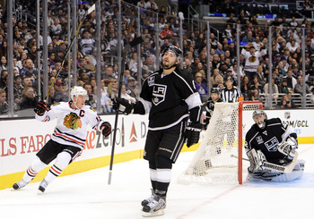 Toews celebrates after giving his team a 4-0 lead in the season-opener.