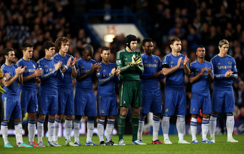 Chelsea players commemorating Dave Sexton with a minute's applause.