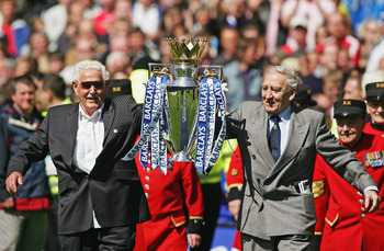Some of Drake's 1955 League-winning team, celebrating with the new Premier League trophy.