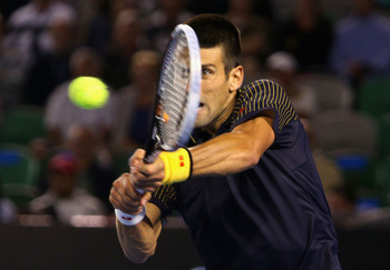 MELBOURNE, AUSTRALIA - JANUARY 20:  Novak Djokovic of Serbia plays a backhand in his fourth round match against Stanislas Wawrinka of Switzerland during day seven of the 2013 Australian Open at Melbourne Park on January 20, 2013 in Melbourne, Australia.