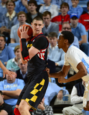 Jan 19, 2013; Chapel Hill, NC, USA; Maryland Terrapins center Alex Len (25) with the ball as North Carolina Tar Heels forward Desmond Hubert (14) defends in the second half. The Tar Heels defeated the Terrapins 62-52 at the Dean E. Smith Center. Mandatory