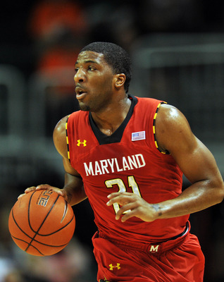 Jan 13, 2013; Coral Gables, FL, USA; Maryland Terrapins guard Pe'Shon Howard (21) dribbles against the Miami Hurricanes in the first half at the BankUnited Center. Mandatory Credit: Steve Mitchell-USA TODAY Sports