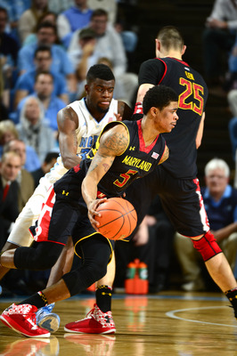 Jan 19, 2013; Chapel Hill, NC, USA; Maryland Terrapins guard Nick Faust (5) dribbles as center Alex Len (25) sets the pick and North Carolina Tar Heels guard/forward Reggie Bullock (35) defends in the second half. The Tar Heels defeated the Terrapins 62-5