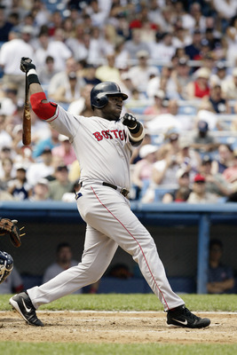 David Ortiz follows through on a home run he hit at Yankee stadium in July 2003.