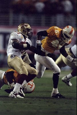 4 Jan 1999:  Travis Minor #23 of the Florida State Seminoles running with the ball while Raynach Thompson #46 tries to catch him during the Tostitos Fiesta Bowl Game against the Tennessee Volunteers at the Sun Devil Stadium in Tempe, Arizona. The Voluntee