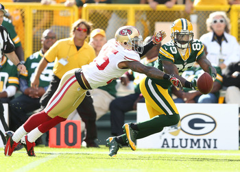 Tarell Brown plays tight coverage on Green Bay's James Jones in San Francisco's victory.
