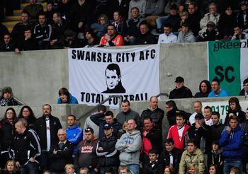 SWANSEA, WALES - APRIL 28:  Swansea fans show their appreciation for their manager Brendan Rodgers and the style of football played by the Swans during the Barclays Premier league match between Swansea City and Wolverhampton Wanderers at Liberty Stadium o
