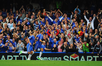 LONDON, ENGLAND - AUGUST 25:  Fernando Torres of Chelsea (R) celebrates in front of fans with Branislav Ivanovic as he scores their second goal during the Barclays Premier League match between Chelsea and Newcastle United at Stamford Bridge on August 25,