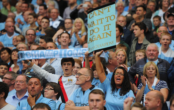 MANCHESTER, ENGLAND - AUGUST 19:   Manchester City fans show their support during the Barclays Premier League match between Manchester City and Southampton at Etihad Stadium on August 19, 2012 in Manchester, England.  (Photo by Michael Regan/Getty Images)