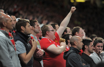 MANCHESTER, ENGLAND - MAY 04: Manchester United fans support their team during the UEFA Champions League Semi Final second leg match between Manchester United and Schalke at Old Trafford on May 4, 2011 in Manchester, England. (Photo by Michael Regan/Getty
