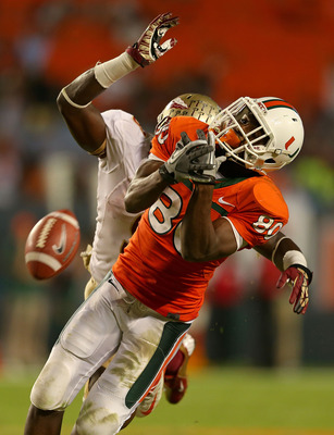 Xavier Rhodes breaks up a pass intended for Miami receiver Rashawn Scott.