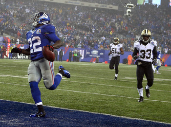 Wilson scores one of his two rushing touchdowns in Week 14 against the Saints.