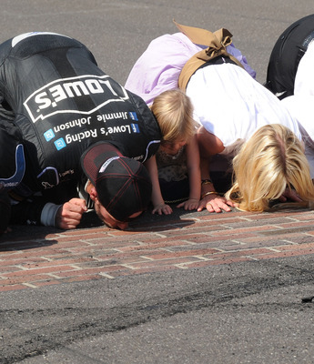 Kissing the bricks after a win at Indy, like they did again last July, never gets old for Jimmie and Chandra Johnson.