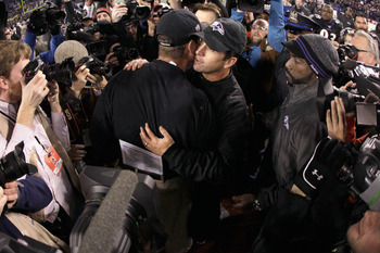 This postgame hug between Jim and John Harbaugh will be repeated after Super Bowl XLVII.