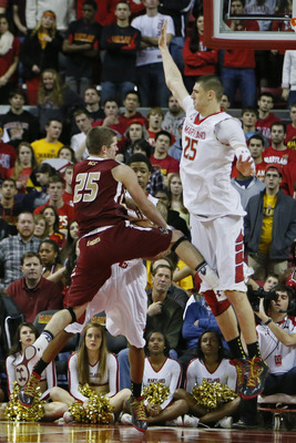 Jan 22, 2013; College Park, MD, USA; Maryland Terrapins guard Nick Faust (5) and center Alex Len (25) take the ball from Boston College Eagles guard Joe Rahon (25) in the closing minute of the game at the Comcast Center. Mandatory Credit: Mitch Stringer-U
