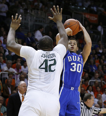 Jan 23, 2013; Coral Gables, FL, USA;  Duke Blue Devils guard Seth Curry (30) shoots the ball over Miami Hurricanes center Reggie Johnson (42) in the first half at the BankUnited Center.  Mandatory Credit: Robert Mayer-USA TODAY Sports