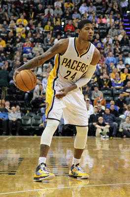 Jan 18, 2013; Indianapolis, IN, USA; Indiana Pacers forward Paul George (24) dribbles in the front court against the Houston Rockets at Bankers Life Fieldhouse. Indiana defeats Houston 105-95. Mandatory Credit: Brian Spurlock-USA TODAY Sports