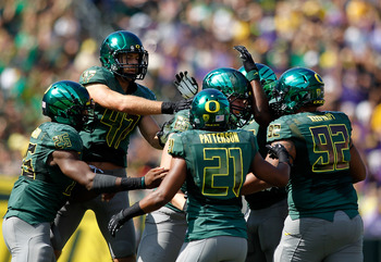 The Ducks' defense celebrates a big play