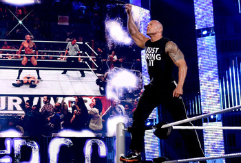 Not sure if anyone has noticed but...The Rock is huge. Photo Courtesy of WWE.com