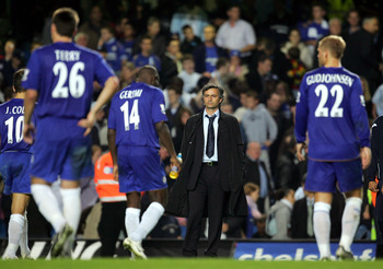 LONDON - OCTOBER 26:  Jose Mourinho the Chelsea manager watches his dejected players walk off after losing the penalty shootout during the Carling Cup Third Round match between Chelsea and Charlton Athletic at Stamford Bridge on October 26, 2005 in London