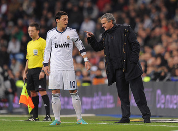 MADRID, SPAIN - DECEMBER 16:  Real Madrid CF head coach Jose Mourinho talks with Mesut Ozil of Real Madrid during the La Liga match between Real Madrid CF and RCD Espanyol at estadio Santiago Bernabeu on December 16, 2012 in Madrid, Spain.  (Photo by Deni