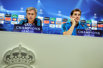MADRID, SPAIN - OCTOBER 17:  Head coach Jose Mourinho (L) of Real Madrid and goalkeeper Iker Casillas listen to questions from the media during a press conference ahead of their UEFA Champions League group D match against Lyon at the Valdebebas training g