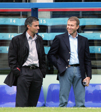 LONDON - AUGUST 24: Manager of Chelsea, Jose Mourinho, (L) talks with Chelsea owner Roman Abramovich  before the Barclays Premiership match between Crystal Palace and Chelsea at Selhurst Park on August 24, 2004 in London.  (Photo by Phil Cole/Getty Images