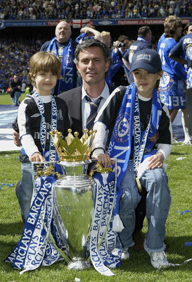 LONDON - MAY 7:  Jose Mourinho poses with his children Zuca (L) and Matilde (R) and the Barclays Premiership Trophy at Stamford Bridge on May 7, 2005 in London, England.  (Photo by Ben Radford/Getty Images)
