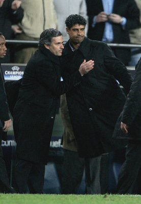 BARCELONA, SPAIN - MARCH 07:  Jose Mourinho, Manager of Chelsea congratulates Frank Rijkaard manager of Barcelona after the UEFA Champions League match between Cheldea and Barcelona at the Nou Camp on March  07, 2006 in Barcelona, Spain.  (Photo by Phil C