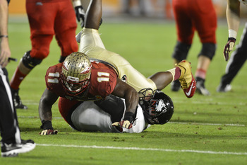Jan 1, 2013; Miami Gardens, FL, USA; Florida State Seminoles linebacker Vince Williams (11) sacks Northern Illinois Huskies quarterback Jordan Lynch (6)  in the fourth quarter of the game at the 2013 Orange Bowl at Sun Life Stadium. The Seminoles defeated