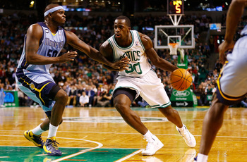 BOSTON, MA - JANUARY 2:  Brandon Bass #30 of the Boston Celtics drives to the basket with the ball against Zach Randolph #50 of the Memphis Grizzlies during the game on January 2, 2013 at TD Garden in Boston, Massachusetts. NOTE TO USER: User expressly ac