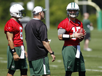 Matt Cavanaugh with Mark Sanchez and Tim Tebow.