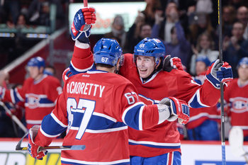 Raphael Diaz (right) and Max Pacioretty of the Montreal Canadiens.