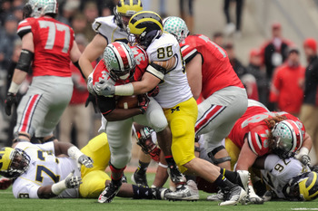 COLUMBUS, OH - NOVEMBER 24: Craig Roh #88 of the Michigan Wolverines tackles Carlos Hyde #34 of the Ohio State Buckeyes at Ohio Stadium on November 24, 2012 in Columbus, Ohio. (Photo by Jamie Sabau/Getty Images)