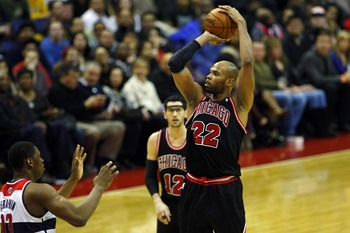 January 26, 2013; Washington, DC, USA; Chicago Bulls power forward Taj Gibson (22) shoots the ball over Washington Wizards power forward Kevin Seraphin (13) in the second quarter at Verizon Center. Mandatory Credit: Geoff Burke-USA TODAY Sports