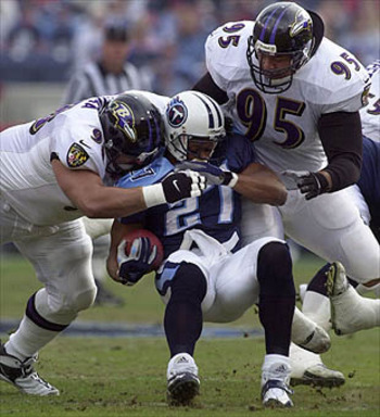 Sam Adams (95) and Tony Siragusa helped to lead Baltimore's record setting run defense.