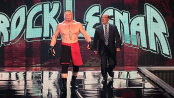 Brock Lesnar with Paul Heyman (Courtesy of WWE.com)