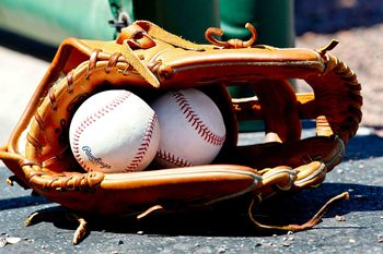 March 25, 2012; Clearwater, FL, USA; A detail of a glove and baseballs during a spring training game between the Baltimore Orioles and the Philadelphia Phillies at Bright House Networks Field. Mandatory Credit: Derick E. Hingle-USA TODAY Sports